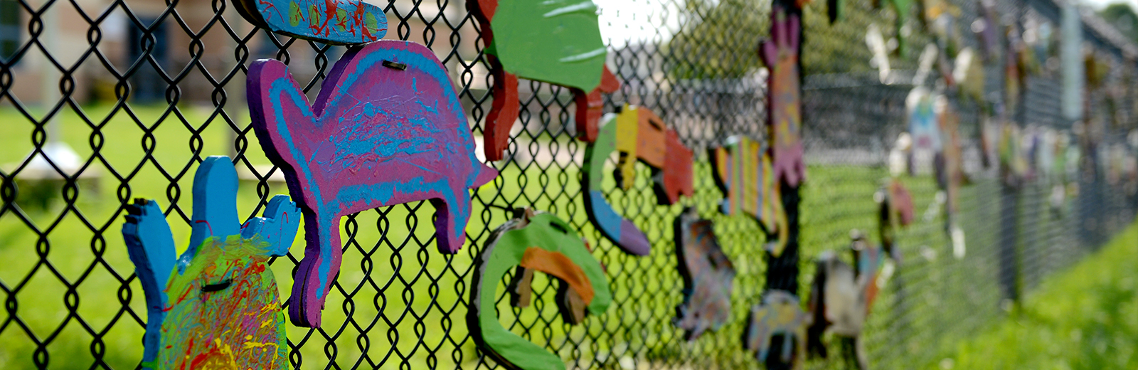 painted fish on school fence