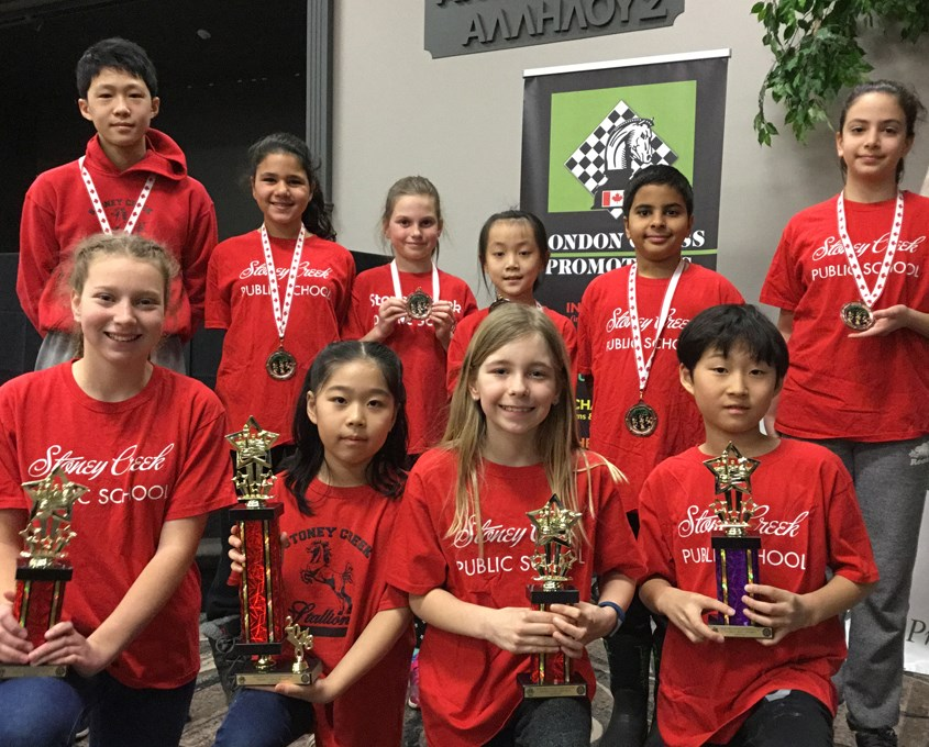 The Stoney Creek Chess Team smiles with their awards