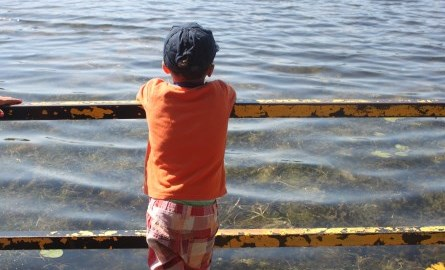 student looking at water