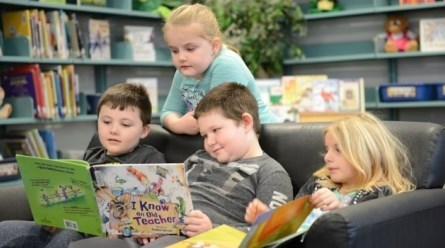 Primary students reading a book