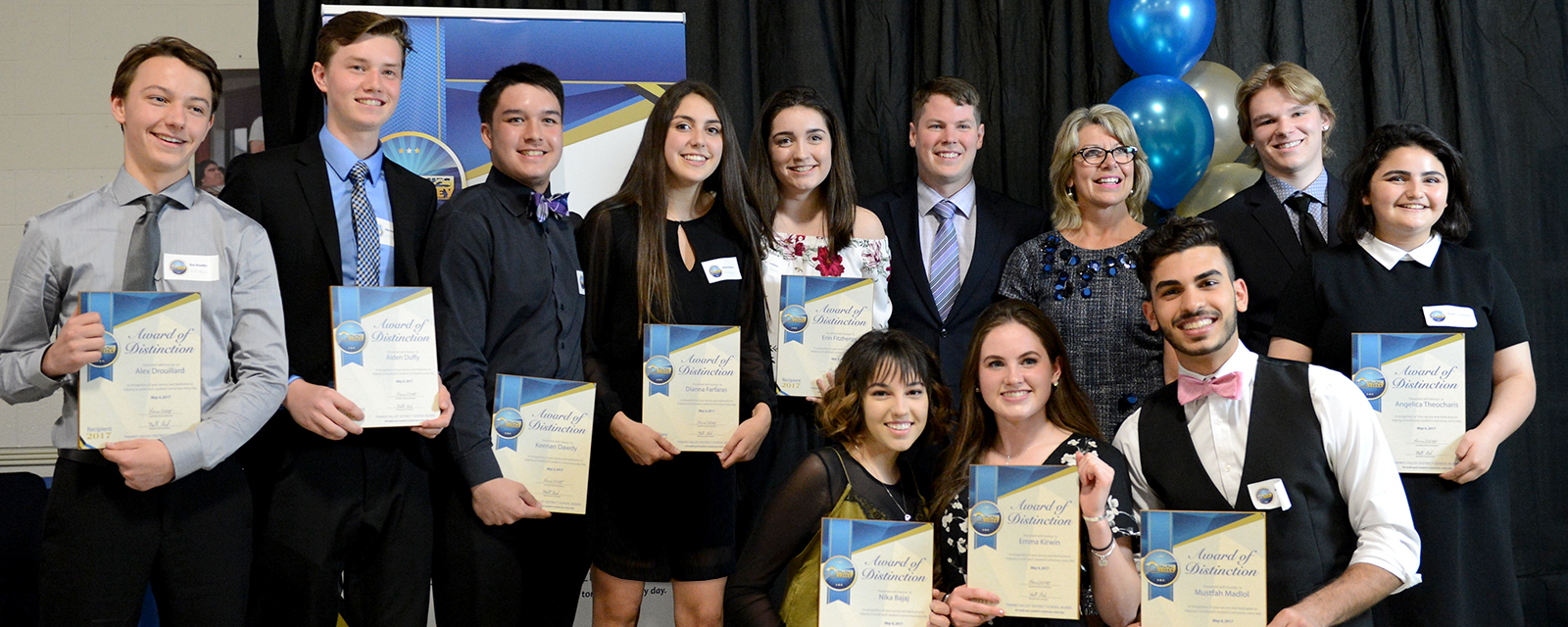 A group of secondary students receive an award
