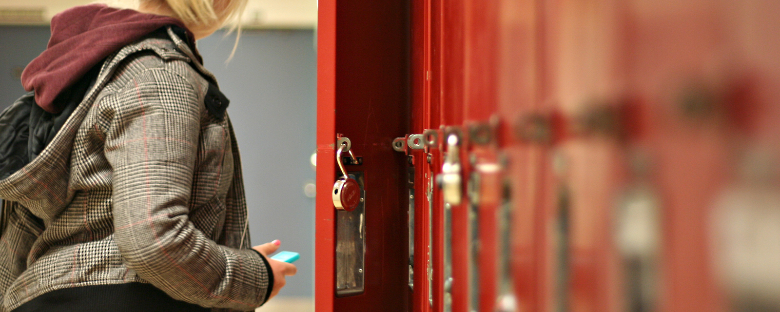 student at lockers